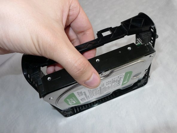 Slide out the hard drive as shown in the picture