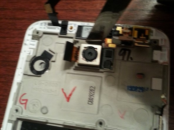 We can now remove the rest of the components: rear camera, vibration motor, and the front camera.
