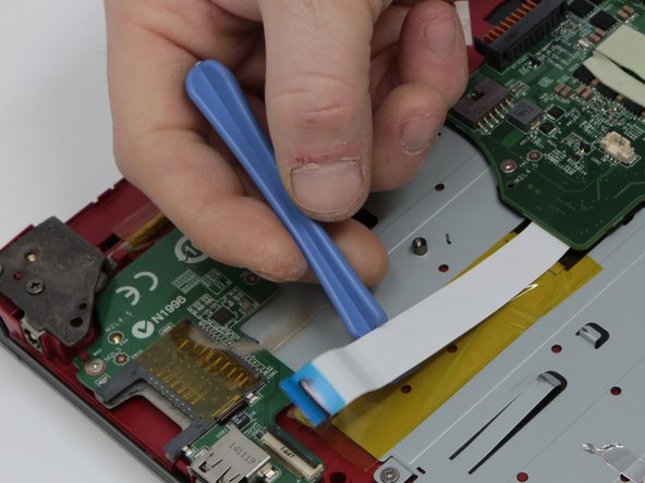 Remove the power and USB connectors that are connected to the left side of the motherboard by  pulling them  from the motherboard and SD  card reader respectively.