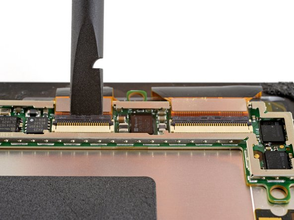 Use a spudger to flip up the small locking flaps on the display cable ZIF connectors.