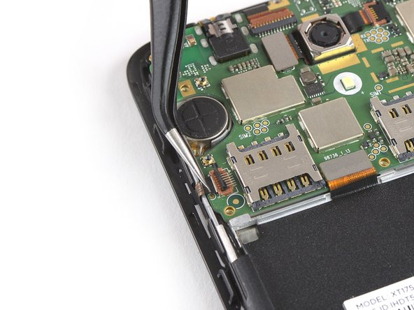 Use a pair of tweezers to pull the power and volume button flex cable out of the ZIF connector.