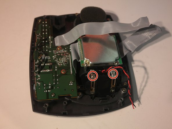 Remove 2 screws to remove the charging contacts in the upper case.
