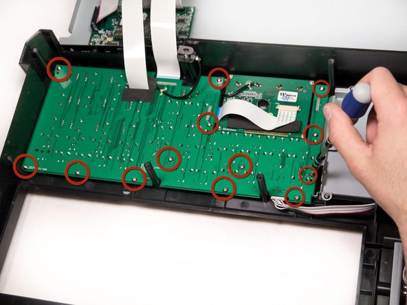 Using a Phillips #2 screwdriver, remove the thirteen 9.8mm silver screws holding the mother board to the face plate.