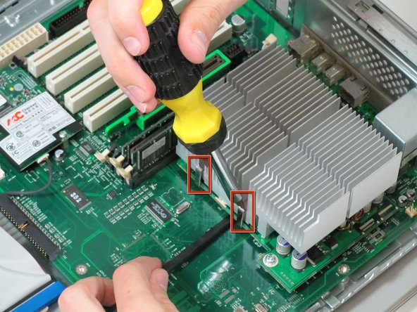 You need detach the heat sink from the CPU. Locate the four clamps holding it down, two on each side.