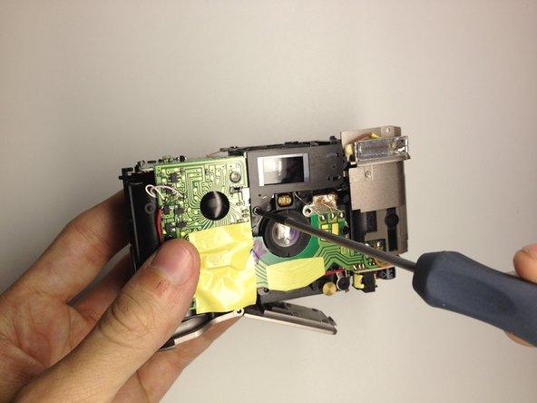 Using the Phillips #00 Precision Screwdriver, remove the screw.