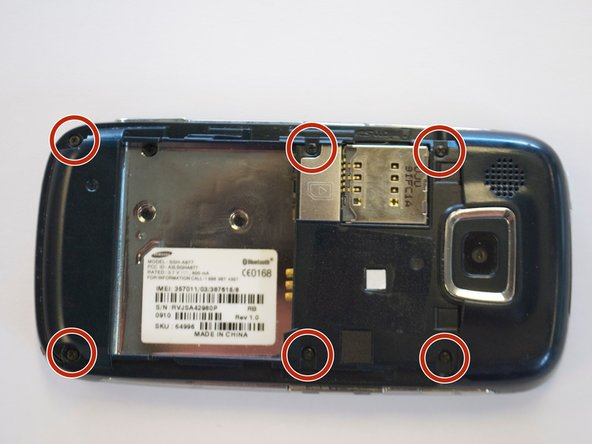 Remove the six 3.5 mm screws using a Phillips #000 screwdriver.