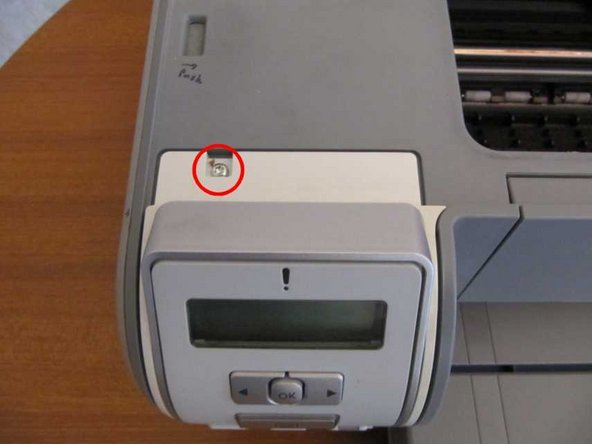 Lift the lid. You will see a single screw at the top of the control panel. Remove this.