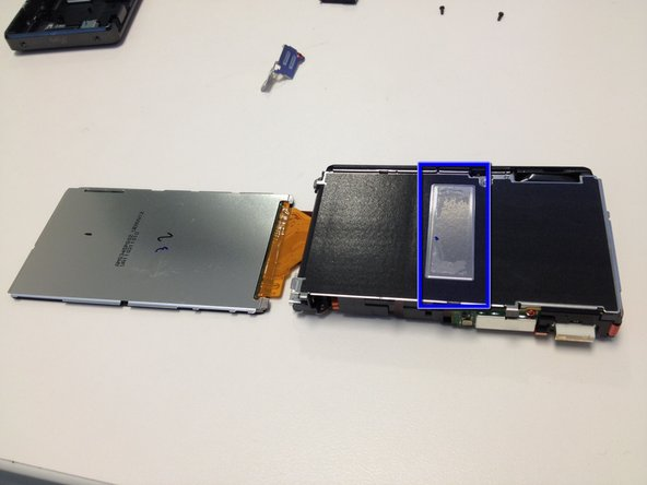 Using an iSesamo Opening Tool, Spudger, or flat dull opening tool, gently pry the OLED/LCD assembly from the adhesive strip on the main body.