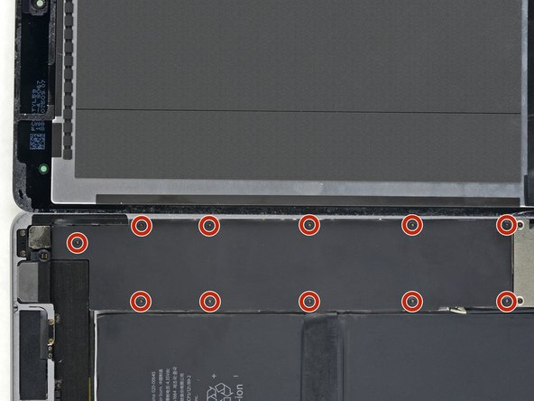 Remove the eleven 1.3 mm Phillips #00 screws securing the EMI shield.