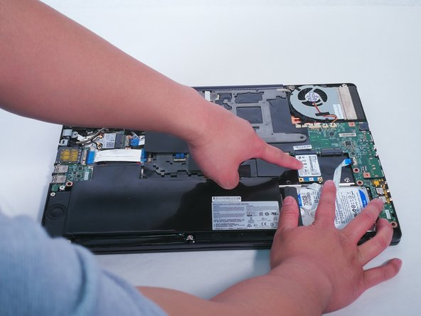 Locate the solid state drive. It is initially obscured by a connector,  its okay to push away the connector to access the solid state drive.