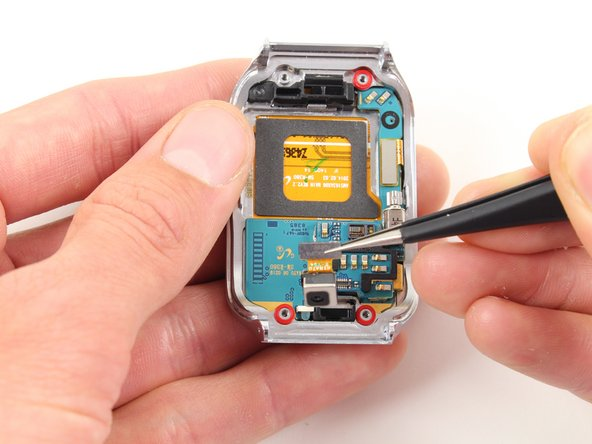 Use tweezers to carefully lift the camera from its slot out of the case.