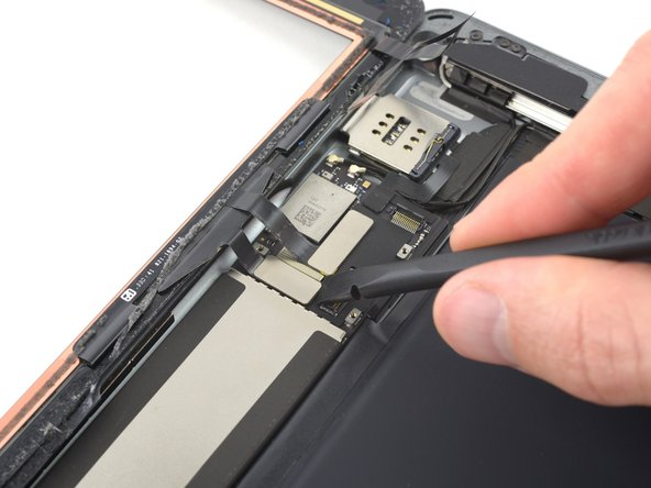 Use the flat end of a spudger or a fingernail to carefully pop the two digitizer cable connectors straight up from their sockets.
