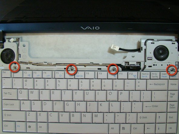 After removing the speaker cover, remove the four screws (Length: 3.6 mm) with your Phillips #0 screwdriver that hold the keyboard in place.
