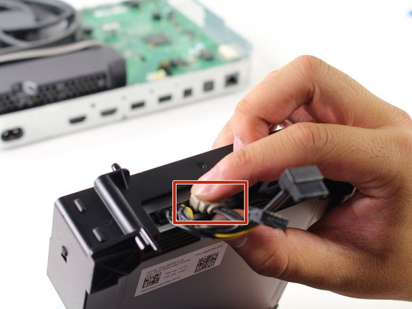Detach the wires from the disc drive and slide the drive out.