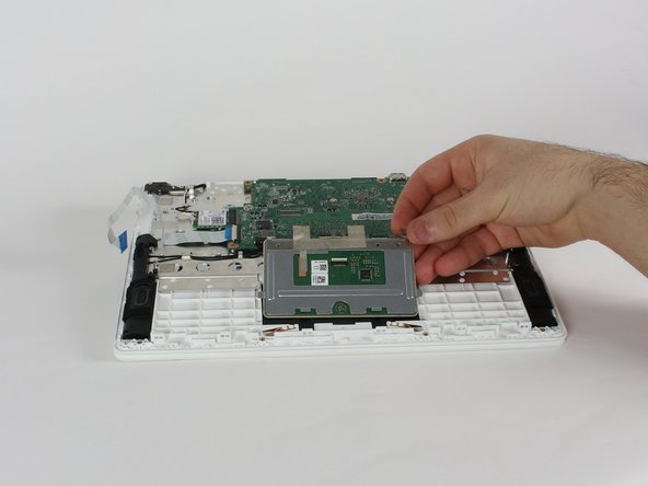 Slide the track pad assembly up towards the motherboard until it can be lifted up and out.