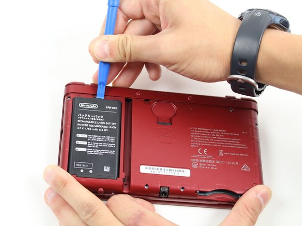 The battery is located on the left hand side of the 3DS - to remove, use the small gap located at the top-middle and pull up with a pointed tool.