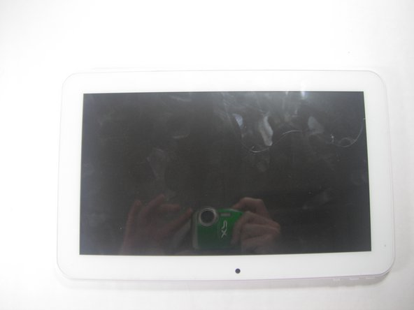 Lay the tablet down on a flat surface with the screen facing up, and the external camera facing upwards and closest to you.