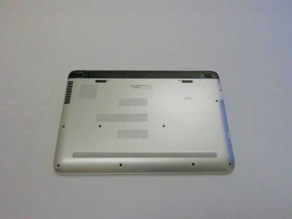 Flip the computer over so that the bottom cover is facing you.