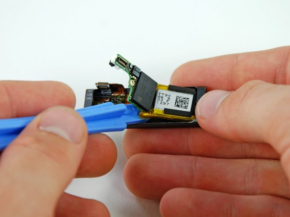 Peel the battery up from the front case with an iPod opening tool.