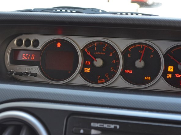 To reset the 'Maintenance Required' light on your dash, turn the ignition to On and press the odometer button until the dash displays Trip A.
