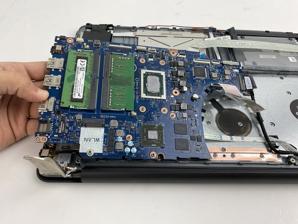 Lift the motherboard up carefully.