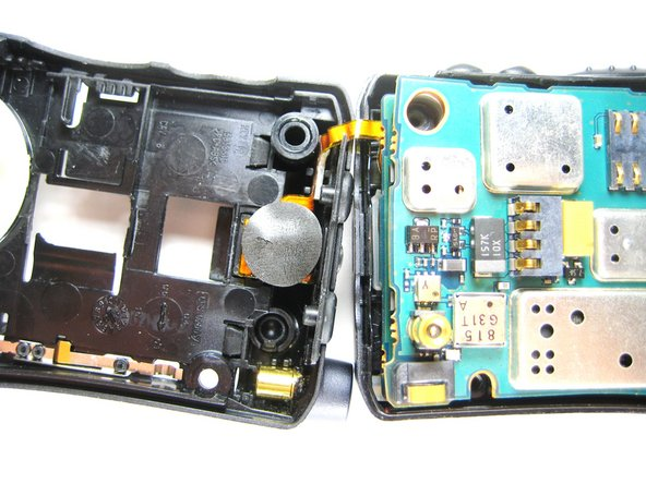 Carefully pry off the connection between the headphone jack and logic board.