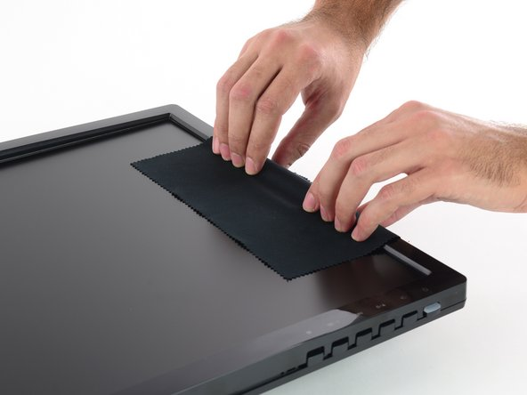 Grip the center of the final side and lift the bezel away from the rear case.