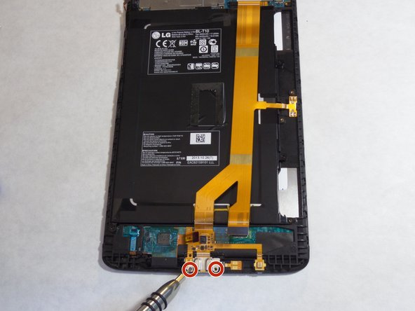 Using the Phillips #000 screwdriver, remove the two 3mm screws located at the bottom of the ribbon cable.