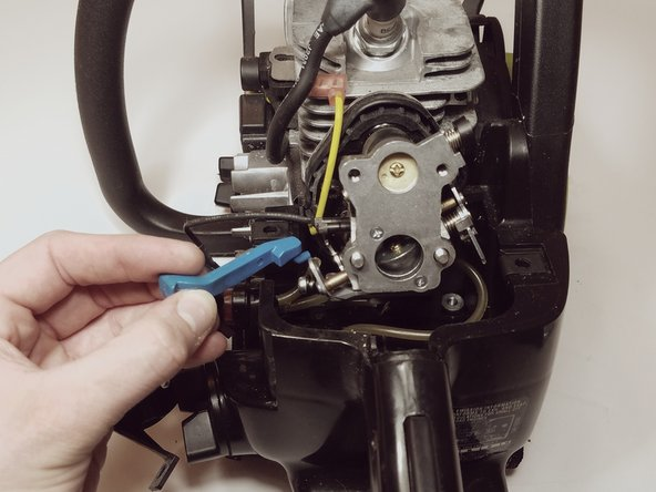 Remove the choke lever from the carburetor and set aside