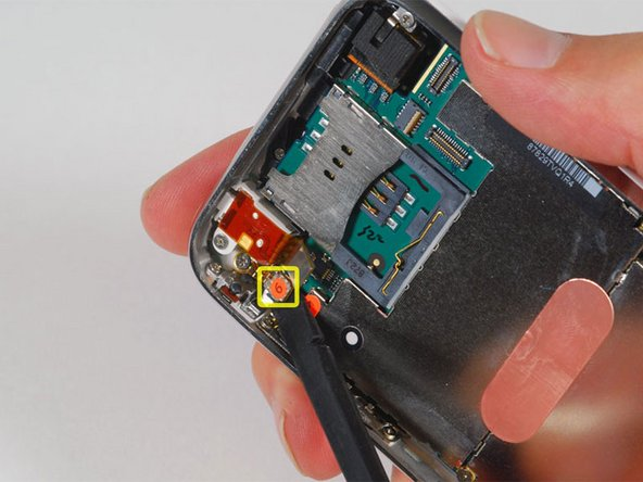"""Use a spudger to disconnect the ribbon cable labeled """"6."""""""