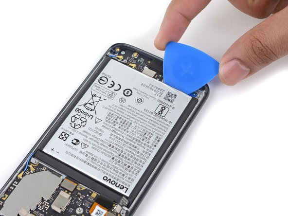 Carefully insert an opening pick under the bottom of the battery.