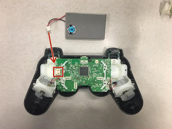 Remove battery by unlatching the battery cables from battery connector clip.