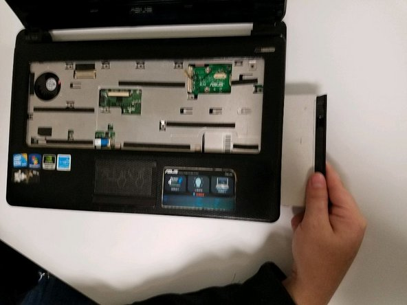 Slide the disk drive out of the device.