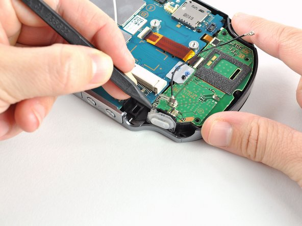 Using a spudger, gently peel up the right shoulder button from the light adhesive connecting it to casing.