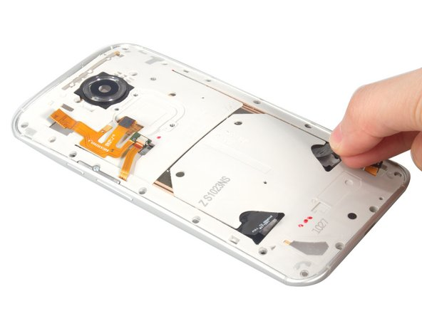Lift one of the two battery adhesive tabs and pull firmly and steadily toward the bottom edge of the phone, until the adhesive strip slides all the way out from between the battery and the phone.