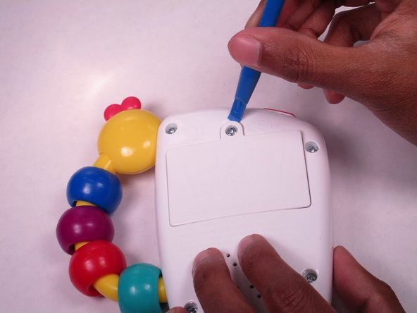 Lift the back with the plastic opening tool.