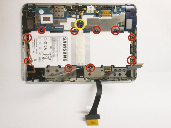 Remove all of the 3 mm screws indicated by a red circle with the #00 Philips Screwdriver.