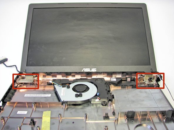 Locate both of the hinges that connect the monitor to the bottom plate cover.