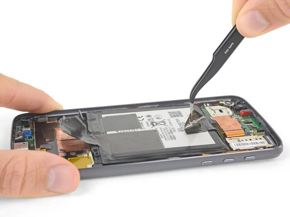 In the following steps you will only lift the battery, do not completely remove it—it's still connected to the motherboard.