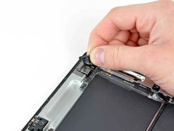Carefully peel the rubber cover off the metal camera retainer and remove it from the iPad 2.