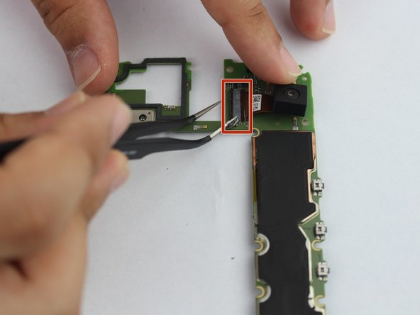 Flip motherboard over to access the rear camera.