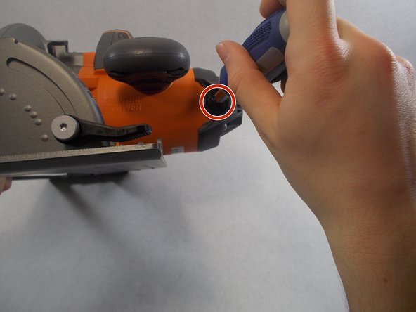 Remove the brush assembly with a flat head screwdriver.