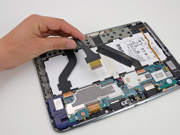While it may appear as though the battery in the Note 10.1 is strapped down à la Gulliver, the ribbon cables are very easy to detach.