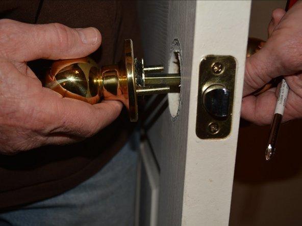 Remove the door knob on both sides of the door.