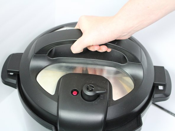 Remove the lid by twisting it counter-clockwise.