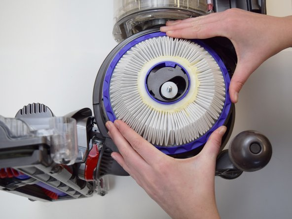 Place both hands on the filter itself and twist counterclockwise until loosened.