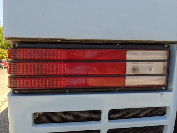 The tail light covers come off easy enough with 10 screws and a single connector.