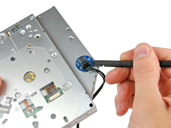 Use the flat end of a spudger to pry the optical drive thermal sensor off the adhesive securing it to the optical drive.