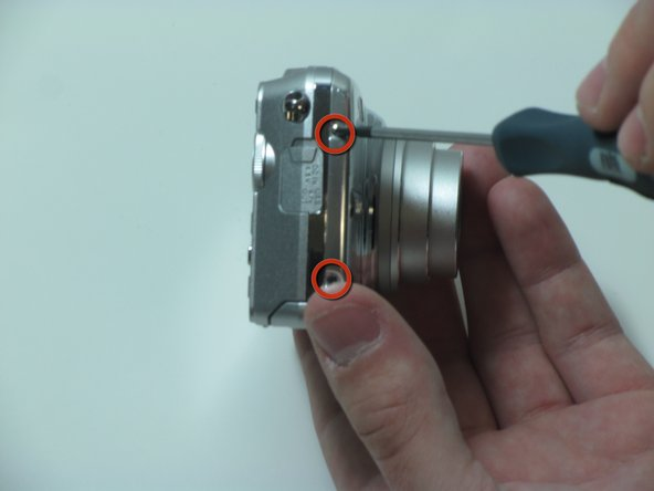 Remove the two screws from the left side of the camera