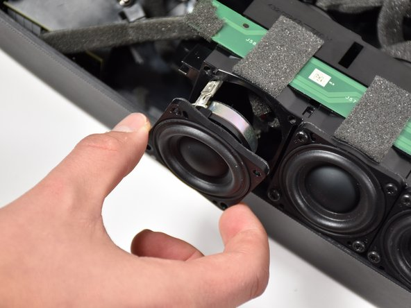Remove the damaged speaker from the array socket, by grasping the speaker with one hand, the array with your other and pulling outward.